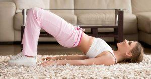 A woman doing OAB Kegel exercises on the floor