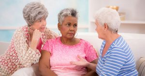 Three Women discussing overactive bladder support
