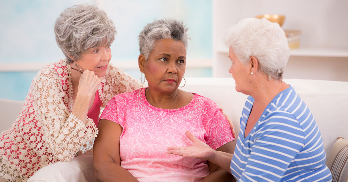 Three mature woman talking